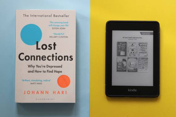 Side by side view of paper book and e-book